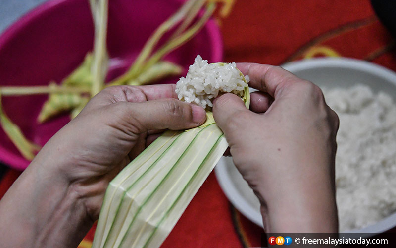 "The rice is cooked and ready to be wrapped with ""daun palas"" (fan palm leaves)."