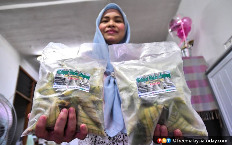 Nadira holds packets of her ketupat, frozen and ready to be sold. Last year, she made 2,200kg of ketupat palas, compared to just 60kg when she first started.