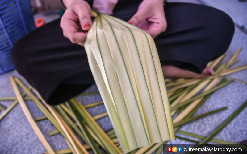 The palm leaf is cleaned before it is cut into ribbon-like strips.