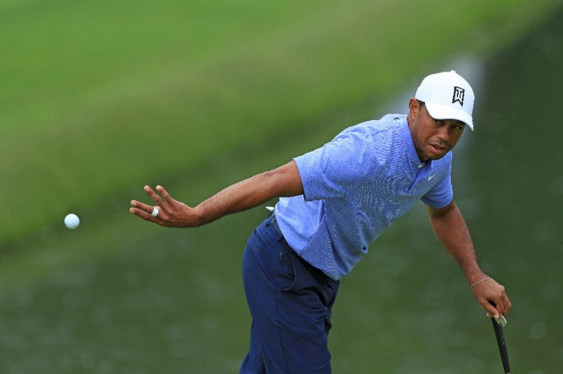 woods makes solid start at memorial as moore sizzles