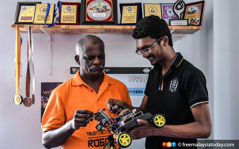 Laveneishyan with his father, B Mogan Balakrishnan. Mogan, a computer science teacher in Seremban, is Laveneishyan's inspiration and mainstay in pursuing his dreams.
