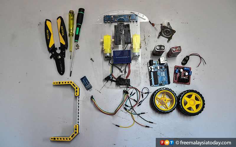 These are the parts and tools needed to build a simple mobile robot. Mobile robots have a base which allows them to move about freely. Laveneishyan's Line Following Robot is an example of a more advanced mobile robot.