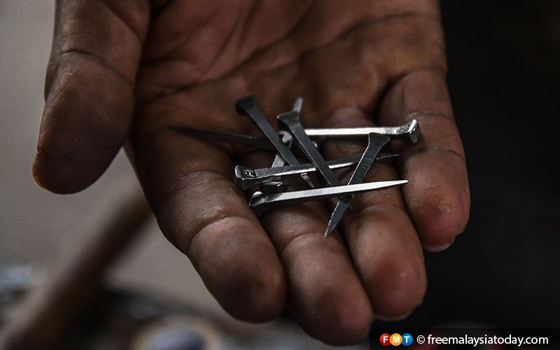 Some of the nails which Kamal uses to hold the shoe in place on the horse's foot.