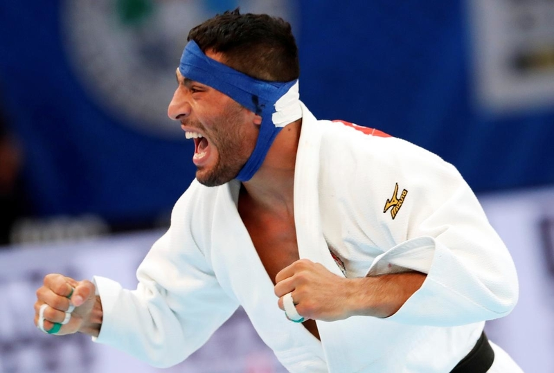 Iran judoka pressured not to fight Israeli, refuses to return home
