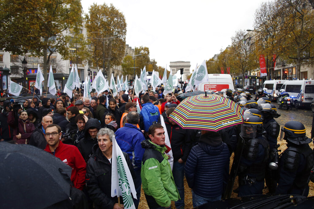 French farmers clog highways to protest at