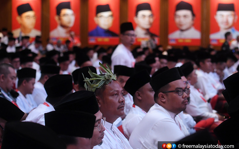 The Orang Asli headgear worn by an Umno delegate stands out in a sea of songkoks.