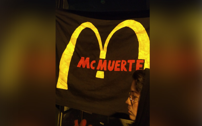 Peruvians protest workers' rights after two McDonald's employees die