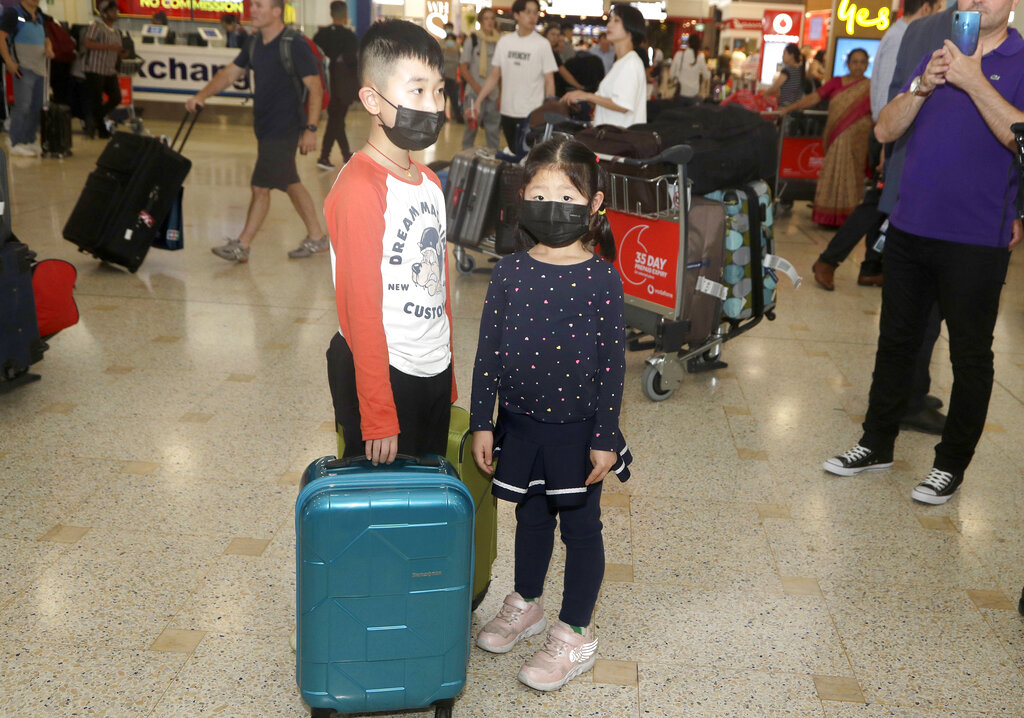 China extends holiday to contain virus as death toll rises to 80