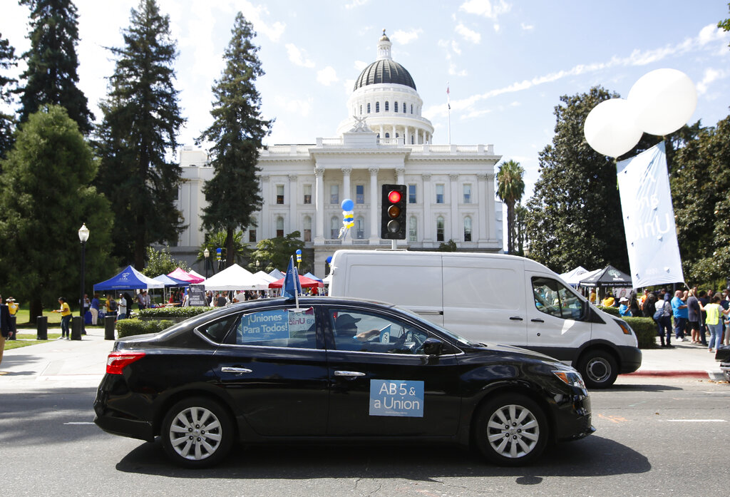 Uber to cut 3,700 jobs, CEO to waive base salary