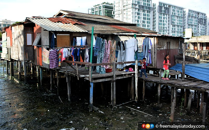 Clothes left out to dry at a house in Kampung Sembulan Tengah, an immigrant settlement in the heart of the Sabah capital.