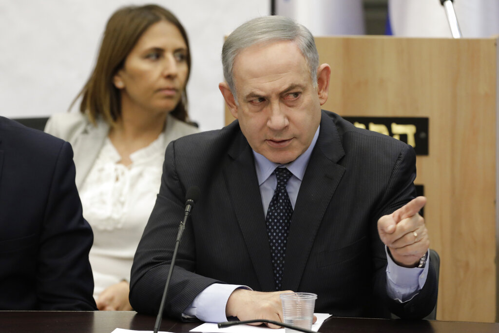 Israeli election gives edge to Benjamin Netanyahu, exit polls show