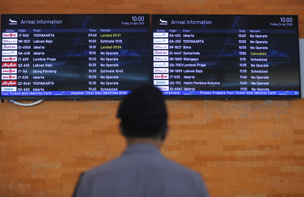 Indonesia brings forward end of air , sea travel ban to May 31