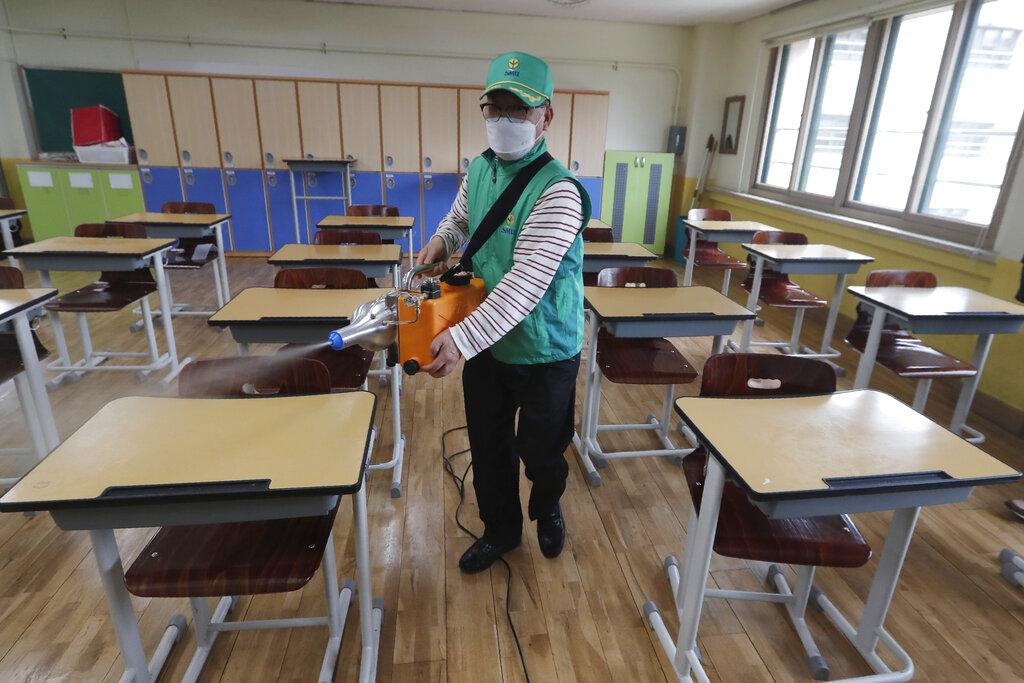 Students return to schools in Seoul as virus cases dip