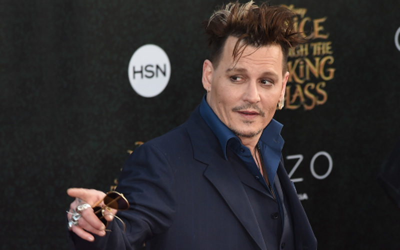 Johnny Depp 'non-violent,' says ex Paradis in UK libel case