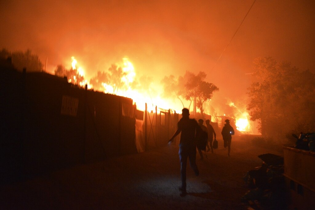 Thirteen migrants detained after second fire breaks out in Greek migrant camp