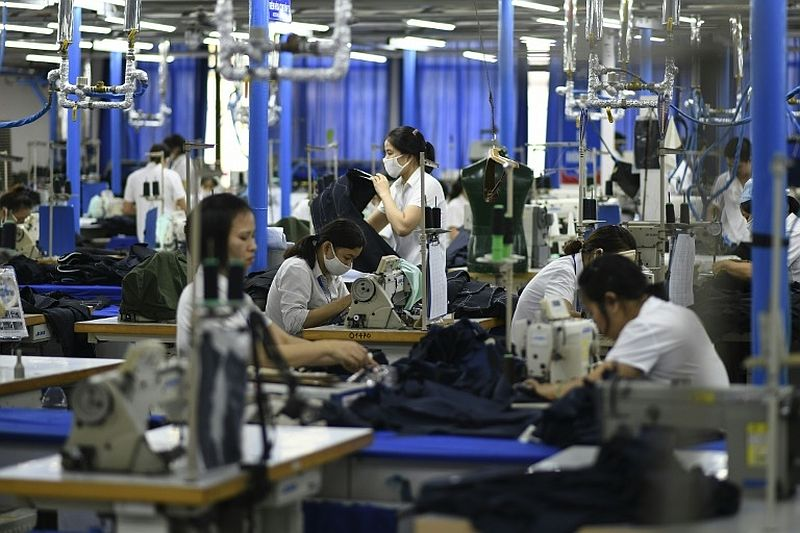 Migrant factory workers in Thailand launch legal action after wages expose