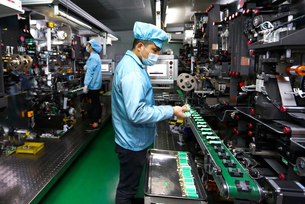 China factory activity expands at slower pace in December