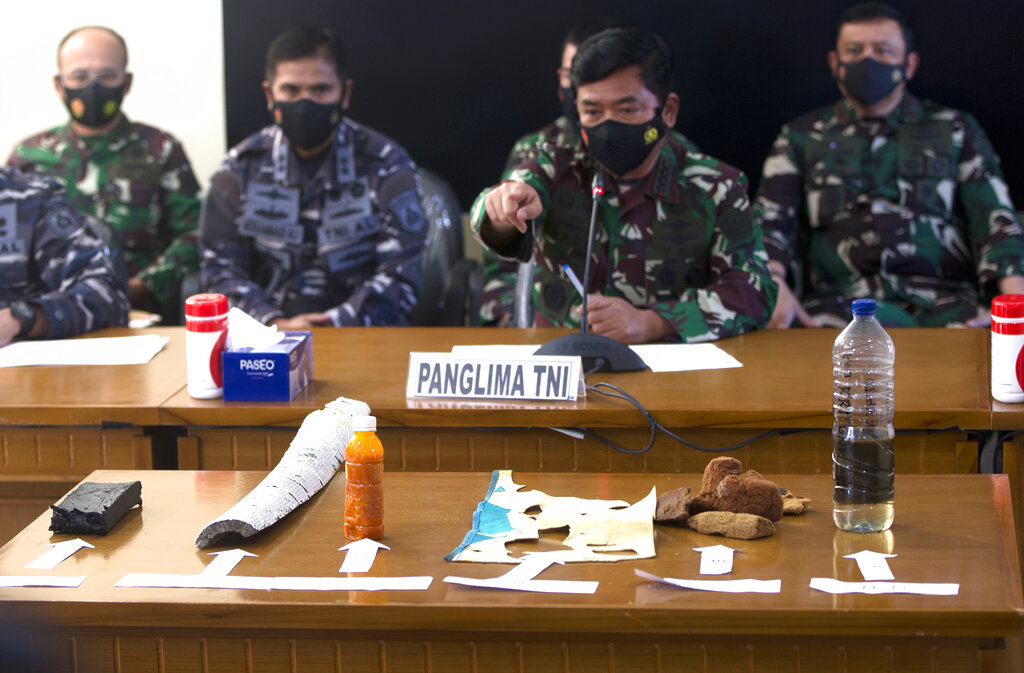 Indonesian military chief Hadi Tjahjanto, points to the debris found in the waters today